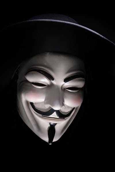 A smiling Guy Fawkes (hacker) mask